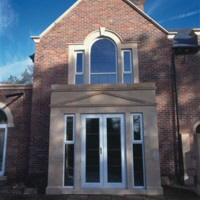 Double doors, side screens and arched window