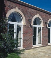 Double doors with arched top lights